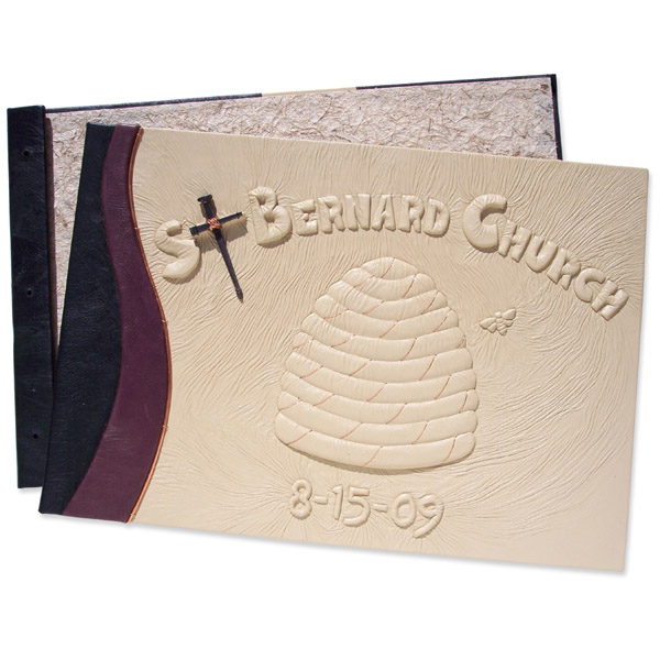 leather screwpost covers with embossed beehive bee skep and lettering with square nail cross