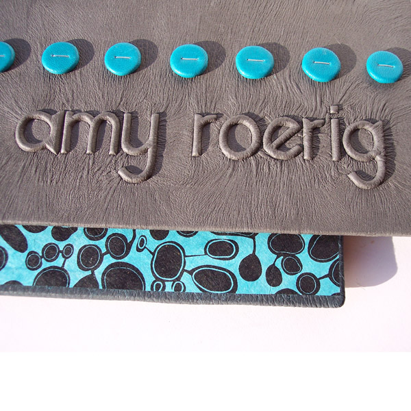 embossed name my under gray leather on book cover with turquoise dots