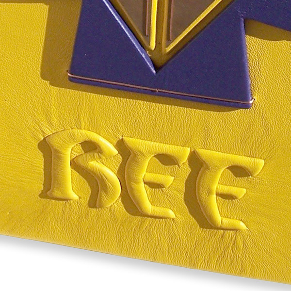 carved yellow leather embossed initials on personalized book cover
