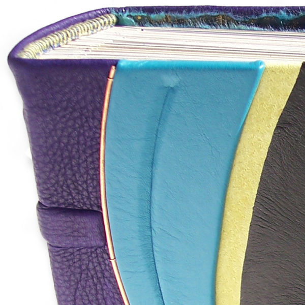 handstiched headband on custom leather photo album with purple, turquoise, lime green, and black leather