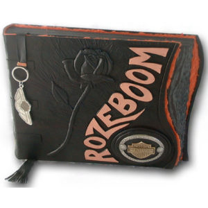 black leather scrapbook with embossed rose, inset Harley-Davidson belt buckle, copper name Rozeboom, Harley keychain bookmark