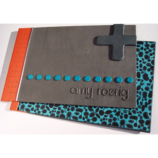 screwpost portfolio covers as refillable artist scrapbook with embossed name, turquoise dot trail, + plus symbol
