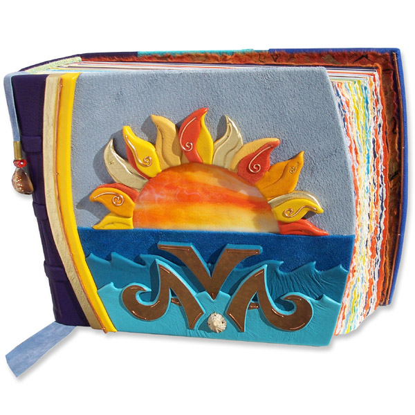 custom leather photo album with orange and yellow stained glass and leather sunset over blue ocean waves, and copper name Ava