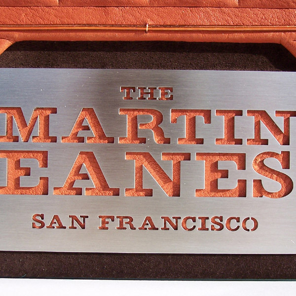 waterjet cut family name logo emblem on stainless steel plate, custom leather scrapbook album detail