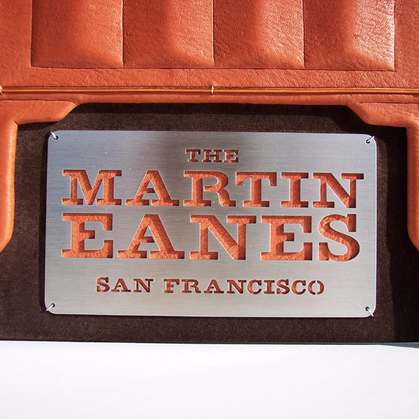 stainless steel waterjet cut family name plate in San Francisco on leather photo album cover