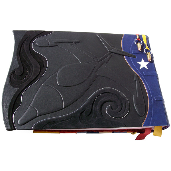 wonder woman's invisible jet sculpture embossed under black leather on scrapbook cover