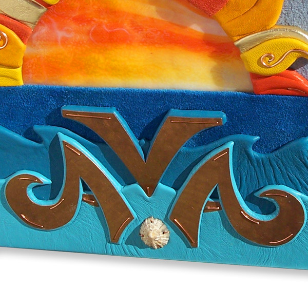 copper name AVA with shell and three levels of carved leather ocean waves on book cover