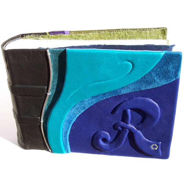 Turquoise and blue leather photo album with embossed initial R