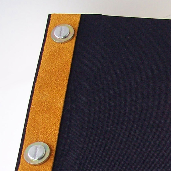 spine edge of scrapbook with gold suede leather strip