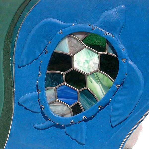 sea turtle leaded stained glass window on blue leather embossed turtle artwork on book cover