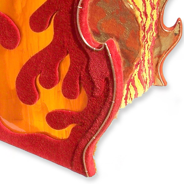 flame shaped book cover edge with red leather around orange stained glass fire window