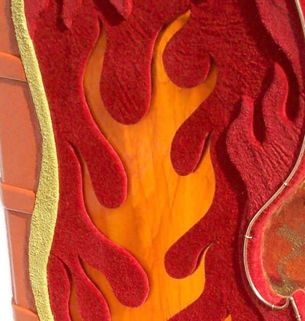 orange stained glass flame window within red leather book cover