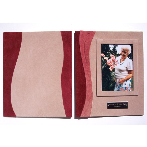 pink leather memorial book with photo under glass and engraved silver name plate on screwpost covers