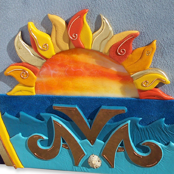 stained glass sunset with leather 3-D rays over ocean waves and copper name Ava on leather photo album cover