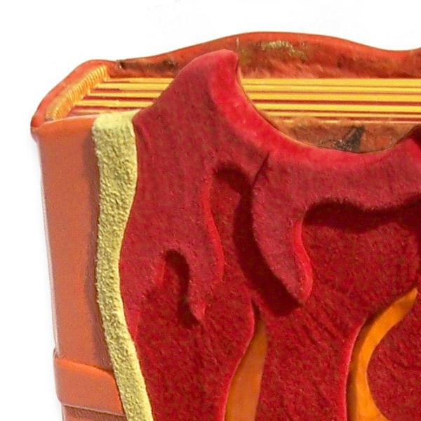 handbound leather photo album detail showing handstitched headbands of spine edge