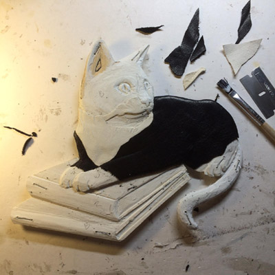 customized pet album cover art, carved leather wrapped black and white tuxedo cat on books