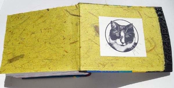 handmade paper endsheets with cat logo in personalized pet photo album