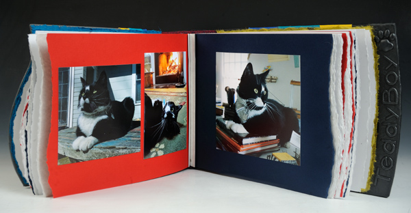 Interior of Customized Pet Album for cat with leather embossed name and pawprint